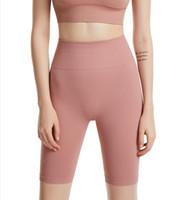 2021 Nuevas mujeres Yoga Sports Shorts Elástico Elástico de las mujeres Levantamiento Fitness Pantalones Capris sin costura