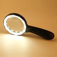زجاج مكبرة مضاءة 10X باليد عقد نظارات مكبرة كبيرة مع 12 LED مضيئة ضوء لكبار السن، إصلاح، العملات