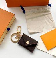 Neue Designer Brief Brieftasche Keychain Schlüsselanhänger Mode Geldbörse Anhänger Auto Kette Charme Braune Blume Mini Bag Trinket Geschenke Zubehör Box