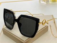 Neue Modedesign Frau Sonnenbrille 0410s Square Platte Rahmen Beliebte einfachen Stil mit Earkette Design UV 400 Schutzbrille