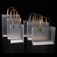 10pcs sac en plastique semitransparent de haute qualité Sacs en PP dépoli avec poignée en papier Difficile plastique Forfait Cadeau Candy Publicité