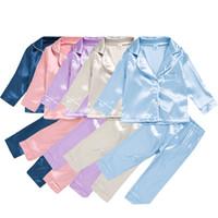 أطفال منامة الفتيات الفتيان الجليد الحرير تتسابق الأطفال الصلبة اللون قمم + السراويل 2 قطع / دعوى أزياء ربيع الخريف ملابس الطفل مجموعات Z2294