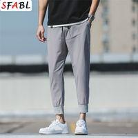 Sfabl Summer Nouvelle tendance Mince Harem Pantalons Casual Solid Pantalon Slim Fit Loisir Pullpants Joggers Hommes Pantalons Elastic Taille Lj201221