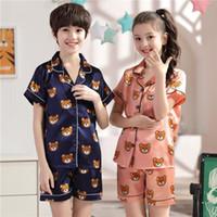 Nueva solapa impresa seda de manga corta pijamas conjunto chicas oso de dibujos animados niños ropa de hogar niño niño pijamas pijamas para niños