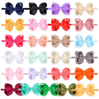 25 colores de los bebés del Bowknot con banda de color puro arco de nylon estiramiento Diadema los niños de los accesorios del pelo M2992