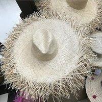 Chapeaux de paille de paille de raffia de grand bord naturel Femmes Summer Beach Caps Casquette Hollow Out Big Paille Chapeaux Y200714