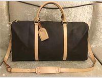 Les hommes blancs Verrouillez les clés femmes sac Duffel sacs de voyage sac à bagages femmes sacs à main en cuir PU grande sacs sac bandoulière 55cm