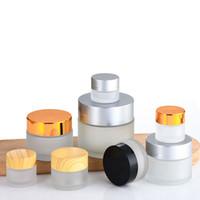 5 10 15 20 30 50 100 g / ml leeres mattiertes runde Glasgläser, mit weißen Inneneinlagen und silbernen Deckeln, High-End-Glascreme-Container
