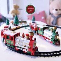 Lichter und Sounds Weihnachtszug Set Eisenbahngleise Spielzeug Weihnachtszug Gift Electric Railway Zug Set W / Lokomotive Motorautos LJ200930