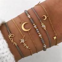 6 PC / Set Retro-Höhle-Stern-Mond Liebes-Kristallanhänger Anhänger Gold-Korn-Armband Female Classic mehrschichtiges Armband