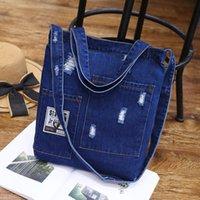 Neue Art und Weise Frauen-Denim-Schulter-Cowgirl Einkauf Damen und Frauen zerrissene Jeans Schule Design Books-Beutel-beiläufige Handtasche Q1107