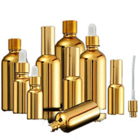 15 stücke Gold Glas Ätherische Ölflaschen Fläschchen Kosmetik Serum Verpackung Lotion Pumpe Zerstäuber Spray Flasche Tropftasche 5/20 / 30ml 201012