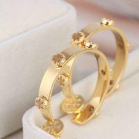 Rea 18 K Altın Kaplama Altın Huggie Hoop Küpe Marka Altın Düğme Moda Sıcak Satış Küpe Kutusu Olmadan
