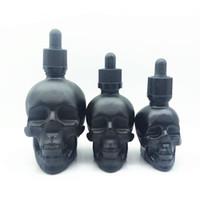 Högkvalitativ 30ml 60ml matt svart skalle huvudglas håroil flaska kropp olja flaska med tyddsäkert lock vid havet todoor skalle dropper flaska