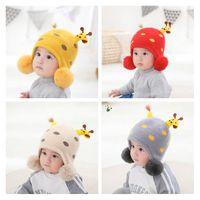 New Children 2020 autumn winter cartoon giraffe knitted cap thickened ear protector baby wool cap knitted cap 6 styles