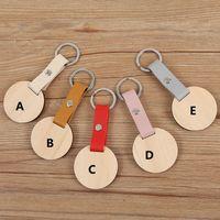 Porte-clés de disque en bois naturel Vente en gros de lettres personnalisées personnalisées vierges Cuir PU ON Bagues Pendentif de disque en bois