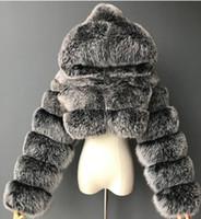 새로운 고품질 모피를 자른 가짜 모피 코트와 재킷 여성 푹신한 탑 코트 후드 겨울 모피 재킷 Manteau Femme