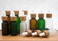 Bouteilles de 30 ml de bouteille de goutte de verre transparente givrée avec capuchon en bambou Casquette Essential Huile de parfum vert
