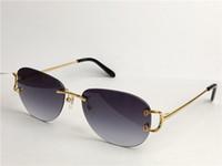 Vente de lunettes de soleil en gros de la mode extérieure 0102 Cadre ronde sans cadre Rétro Avant-Garde Design UV400 Couleur de lumière Lunettes décoratives