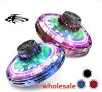 Venta al por mayor 100 unids / lote Original Flynova UFO GAG Toys Toys Spinners Mano Volando Spinner Mini LED Drone Separador Luz de giro Spinning Toys Regalo de descompresión