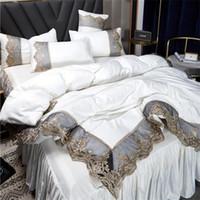 الساخنه بيع مجموعات الفراش 4 قطع لوازم الفراش الصلبة سرير البدلة غطاء لحاف الحرير الرباط سرير تنورة مصمم في سوق الأسهم