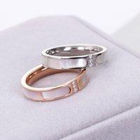 Новая низкая цена мода три бриллиантовых оболочков кольцо, женское розовое золото покрытый титановый сталь