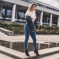 Женские джинсы мелодия мелодия четырех способов растягивающуюся высокую талию молния jeggings супер тощий спандекс эластичные хлопковые джинсовые женские лета1