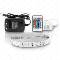 5m 300LEDS Nicht wasserdichte RGB-LED-Streifen-Licht 3528 DC12V 60LEDS / M Flexible Beleuchtungsstring-Band-Band-Lampe Home Dezember-Lampe