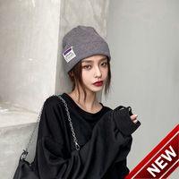 Chapeau femelle automne et hiver double couche épaissie laine chaude lettre coréenne lettre étiquette tricotée de la mode pulls hommes mange