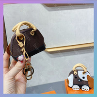 النساء المصممين المصممين حقائب 2020 رجل محفظة الرجال حامل بطاقة الائتمان عملة محفظة مفتاح الحقيبة محافظ شل حقيبة مع زهرة الكلب الأزياء