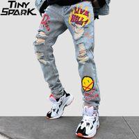 Мужчины джинсовых штанов Граффити Streetwear Hip Hop Разорванные Дыры джинсовых брюк Harajuku Проблемных Denim Pant Жан брюки Мода Q1110