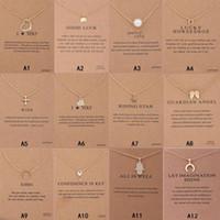 Nouvelle arrivée Collier DreeRed avec carte-cadeau Elephant Pearl Love Ailes Croix Touche Zodiaque Signe Compass Lotus Pendentif pour Femmes Mode Bijoux