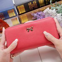 Neue Tasche Berühmte lange weibliche Brieftaschen Kupplung Mode PU Halter Bowknot Münze Geldbörsen Geldbörsen Telefon Marke Designer Leder Karten Dame Frauen Qinlr