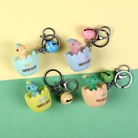 Muñeca dinosaurio liberación del huevo Llavero de la moda de Prensa de dibujos animados Toy colgante llavero del encanto de la decoración del coche llavero Mochila
