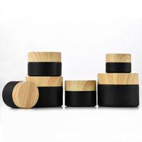زجاج بلوري أسود الجرار الجرار مستحضرات التجميل مع الأغطية البلاستيكية خامة الخشب PP بطانة 5G 10G 15G 20G 50G 30 مرطب الشفاه الحاويات كريم