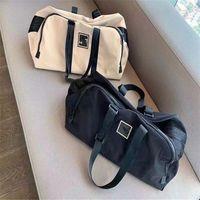 luxurys concepteurs sacs unisexes sacs de voyage de grande capacité sac de sport haute qualité sport sacs de rangement de style classique Sac de rangement