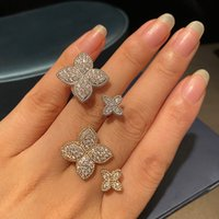 good quality trendy fashion silver and gold four leaf style ring for woman girl lady designer wholesale supplier