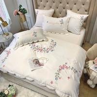 Francês luz de luxo de estilo gelo seda bordados de algodão quatro peças capa de edredão de estilo europeu, roupa de cama de algodão branco comércio exterior jogo de cama