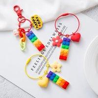 Lindos bloques de arco iris cadenas niños niñas dibujos animados campanas anillo encantos bolso pandent regalo para amigo titular de la llave