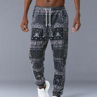 Hip Hop Gevşek Fit Elastik Bel Pantolon Baskılı Yan Cep Ayak Bileği Erkek Rahat Drewstring Sportwear Joggers