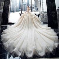 Vestido de novia vestido de bola de la cena magnífico cristalino brillante del cordón de Wih de la capilla de tren V-cuello 2020 hombro de arco princesa vestidos de novia Q1113