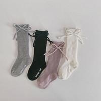 Arcos para niños Calcetines Otoño Invierno algodón de los niños de la mariposa antideslizante Medias Princesa de la muchacha de la raya de punto 3/4 Rodilla calcetines S860