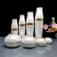 El sistema entero cosmética Packaing lujo blanco / botellas de acrílico de oro para cosméticos botella de spray y bote de crema 5 g 10 g 30 g 50 g