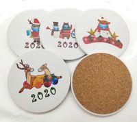 クリスマスのテーマの陶磁器のテーブルマットの飲み物コースター卓球創造的なコーヒーマグカップコースター耐熱禁止カップボトルパッド