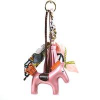 Fashion Marque PU Horse Porte-clés de soie Ruban de soie Cuir Tassel Tassel Clé Chaîne Clé Chaveiro KeyRing Femmes Charm Sac Pendentif