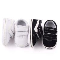 0-2 سنوات من العمر المبيعات الساخنة الصبي وفتاة الطفل قماش أحذية الوليد الطفل أول مشوا أحذية لينة سوليد غير الانزلاق أحذية أطفال