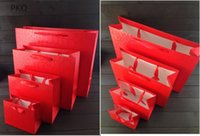 Envoltura de regalo 12 unids / lote 14x11x6cm Pequeña bolsa de papel kraft gruesa cartón de cartón 250gsm con cadena para compras de ropa