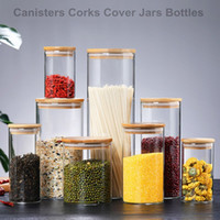Botellas de almacenamiento de alimentos transparentes de vidrio Cubiertas de tapaces Frascos de frascos para alimentos líquidos de arena Botellas de vidrio ecológicas con tapa de bambú en stock
