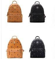 Echtes Leder Stil Student Reiserucksack Hohe Qualität Männer Frauen Niet Rucksack Berühmte Handtasche Designer Mädchen Jungs Mode Schultaschen