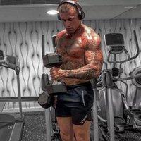 Мужские шорты летние повседневные хлопковые мужчины спортсмены фитнес бодибилдинг дышащие спортивные штаны мужские короткие брюки эластичные MMA боксер1